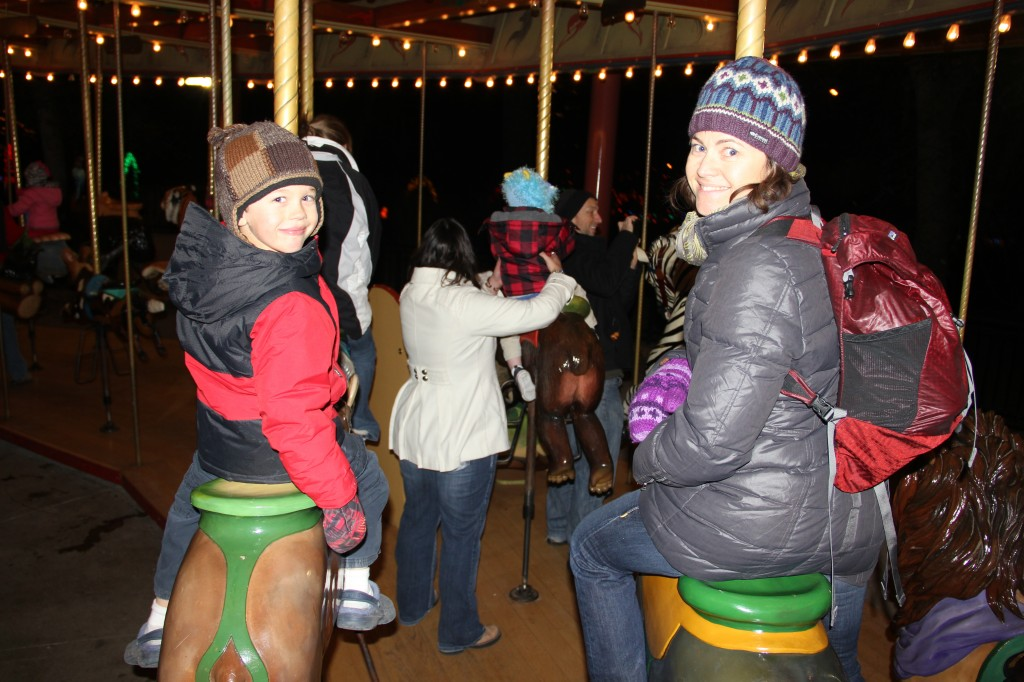 Riding the carousel at Zoo Lights