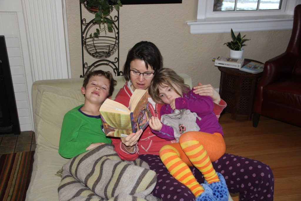 Marcy reading Harry Potter to Jude & Anna with both kids not feeling well