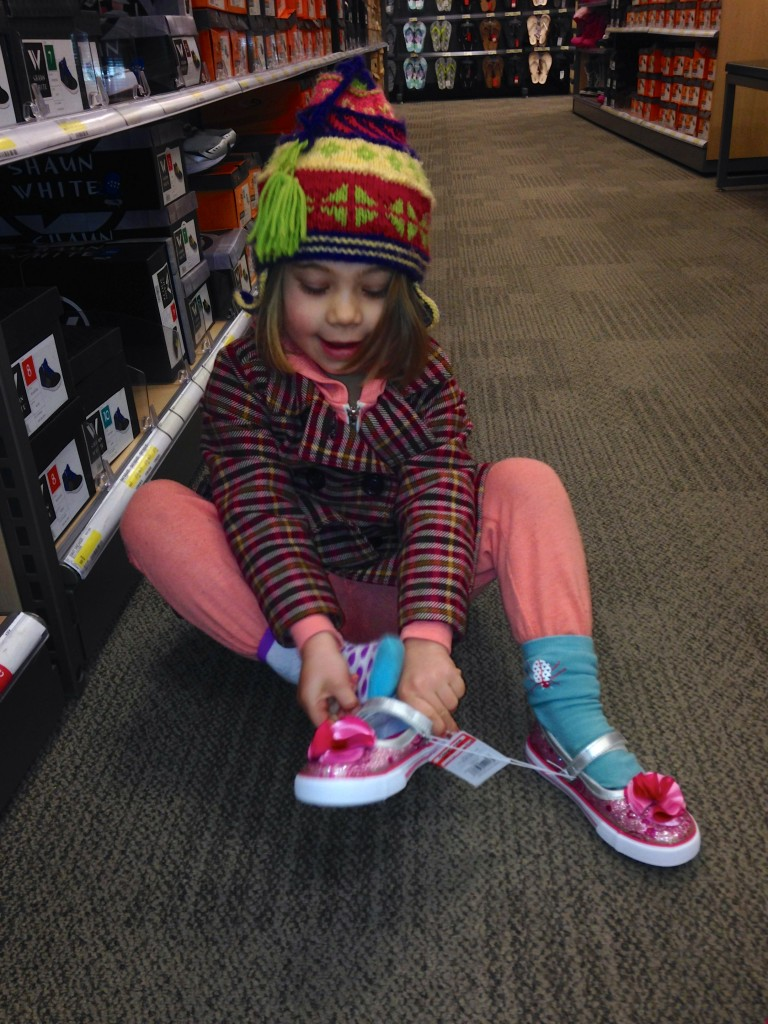 Anna doing her favorite pastime - shopping for shoes at Target