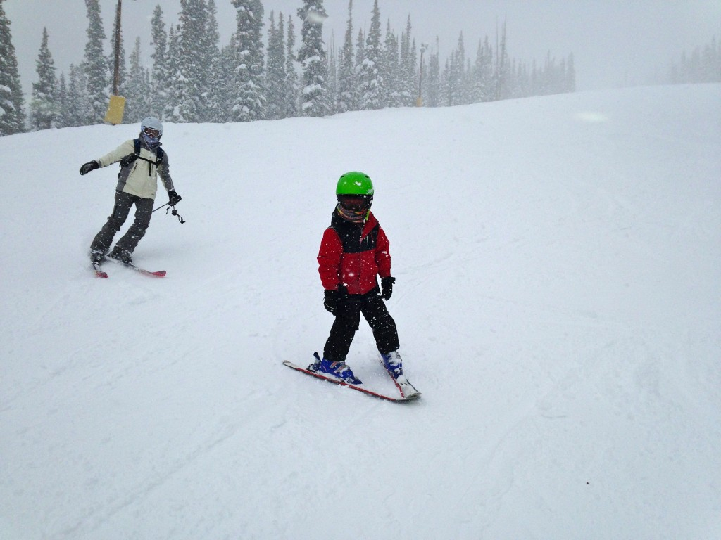 Jude skiing down a blue run at Keystone with Marcy right behind him