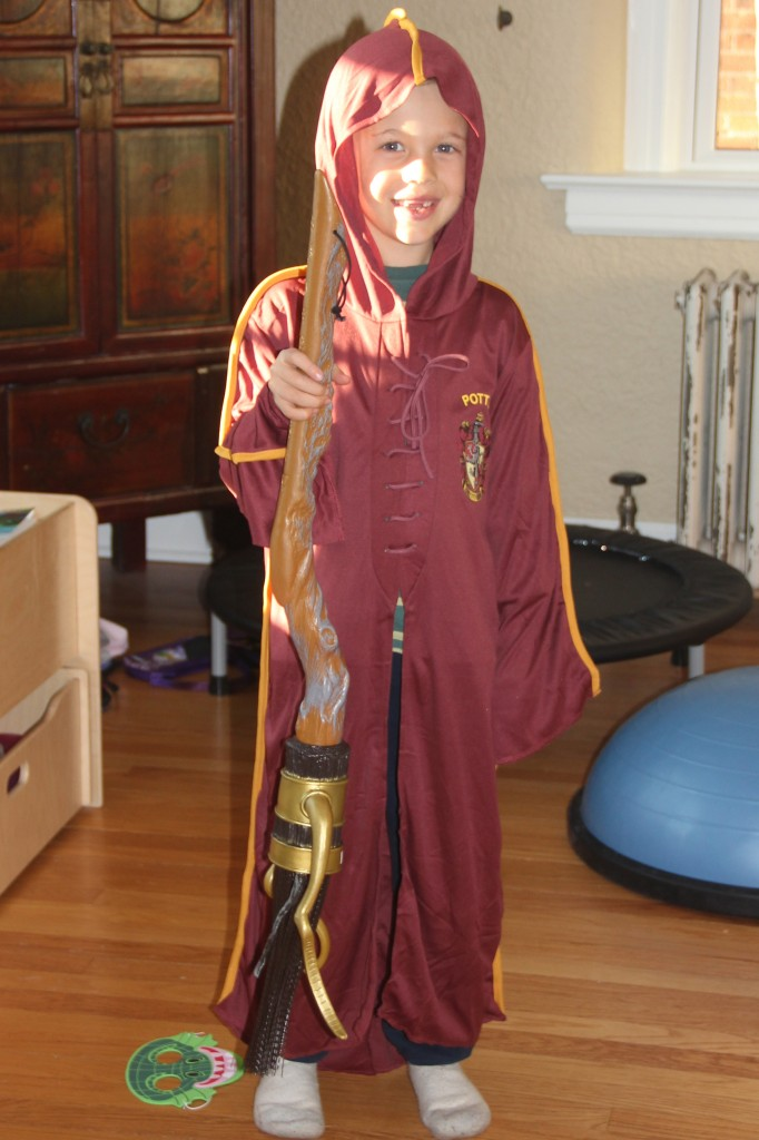 Jude is his Harry Potter Gryffendor Quidditch robes along with his Firebolt broom