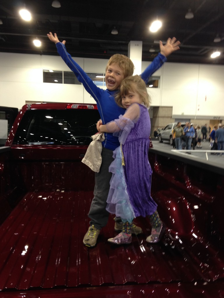 Enjoy each other's company in the back of a pickup truck at the Denver Auto Show