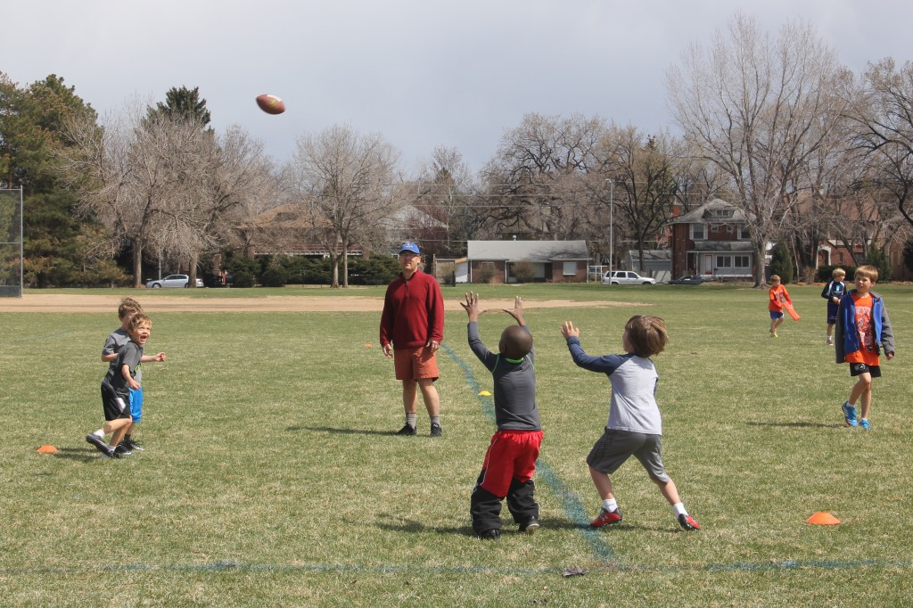 Jude playing quarterback on his flag football team