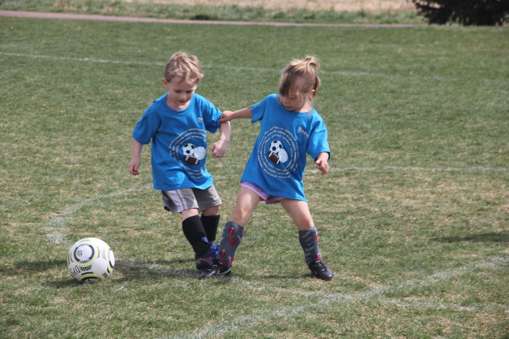 Anna in action on the field in her first soccer game