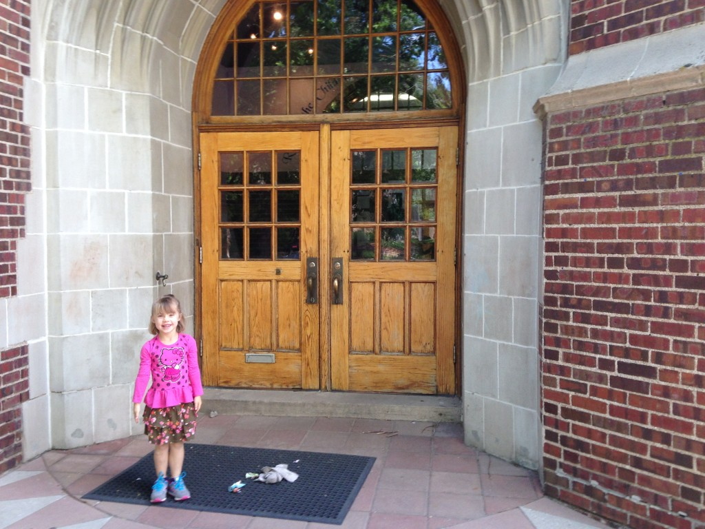 Anna outside her school on the last day before summer vacation