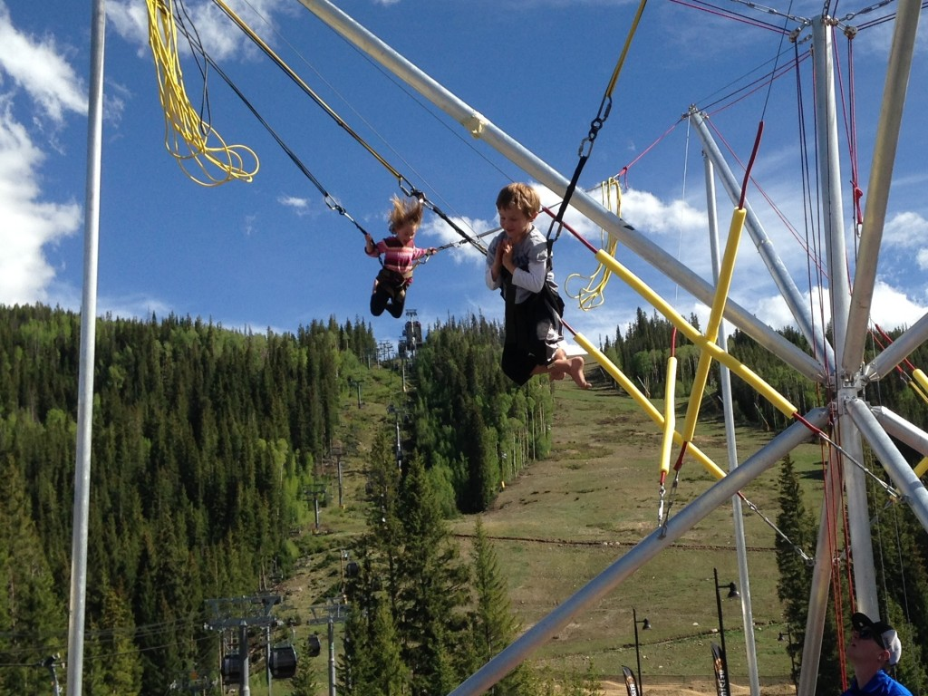 Anna and Jude on the bungee trampoline in Keystone