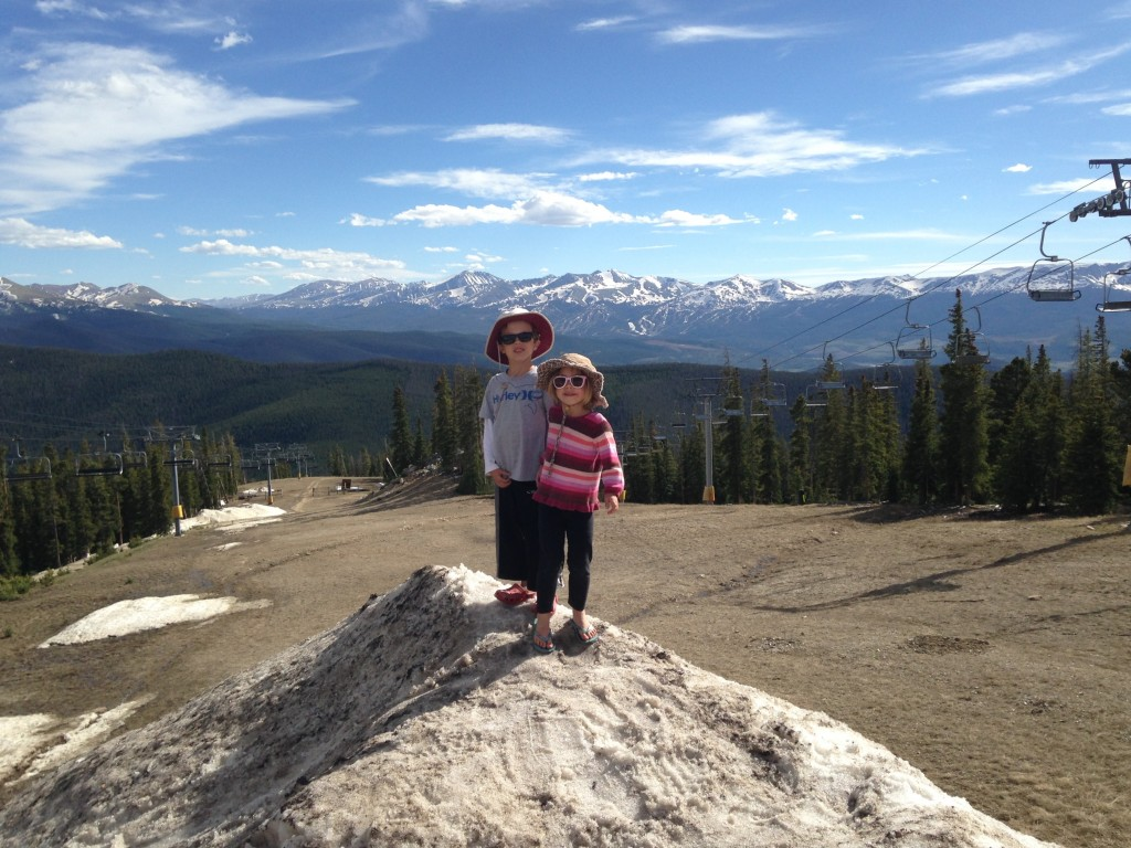 Anna and Jude on the top of a snow bank at the top of Keystone mountain