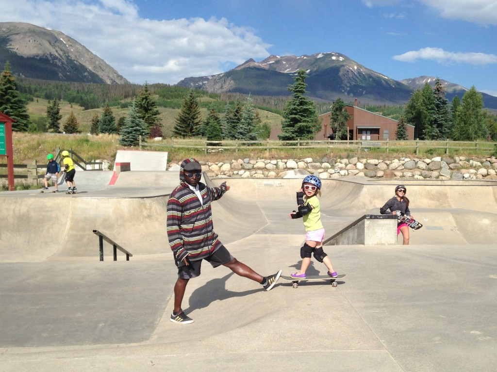 Anna with her instructor at skateboard camp