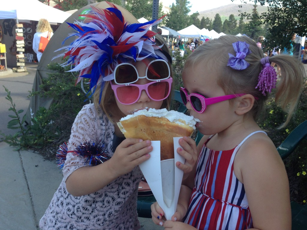 Anna and Chloe enjoy their strawberry and cream crepe