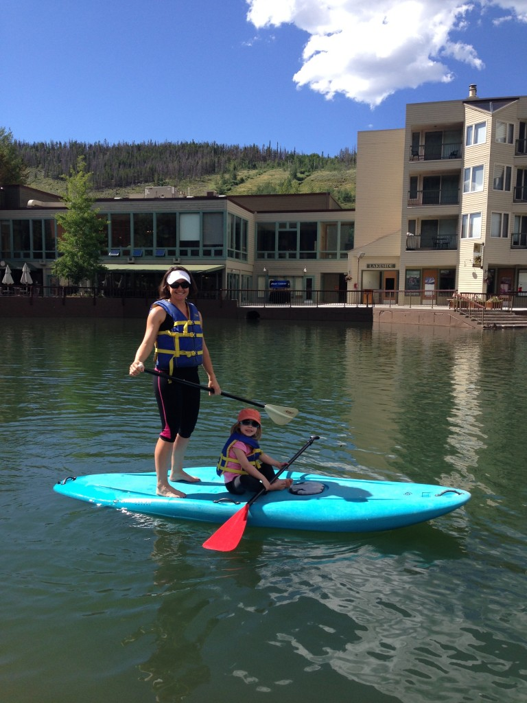 Marcy and Anna on Keystone Lake doing Stand Up Paddleboarding