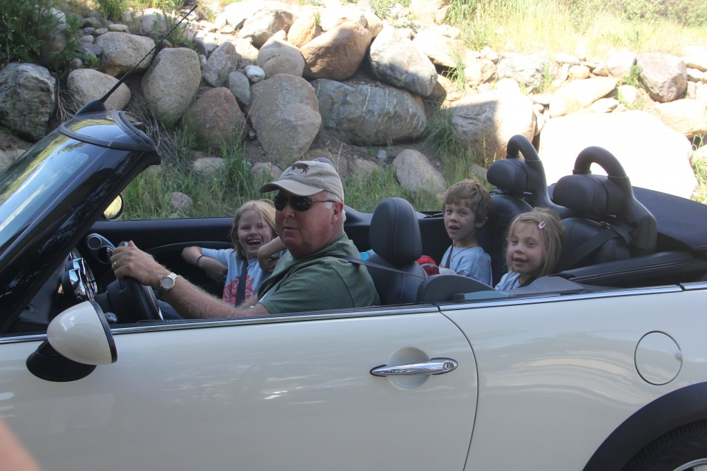 The kids love driving around in the Mini with Grandpa