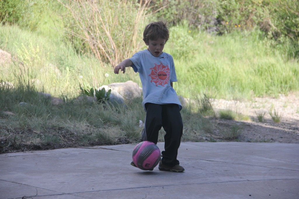 Jude showing his style and focus during our driveway soccer match