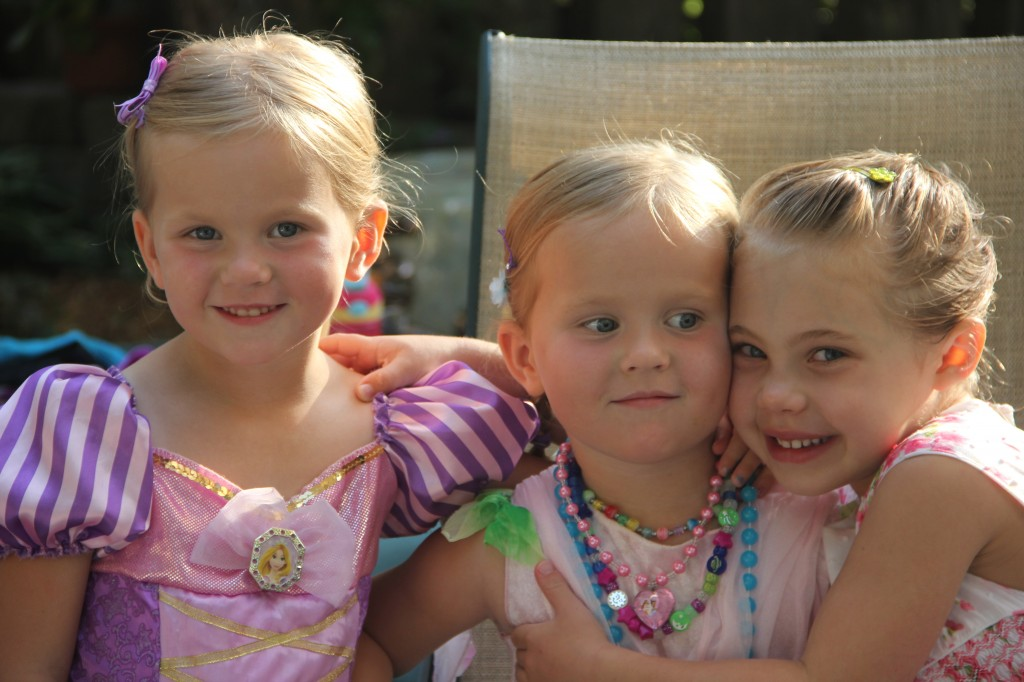 Ella, Chloe and Anna dressed up in their princess outfits to see Frozen