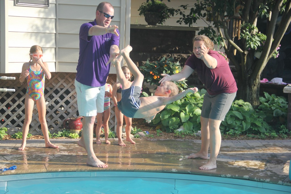 Jude getting thrown in the pool by Uncle Nathan and Aunt Mandy