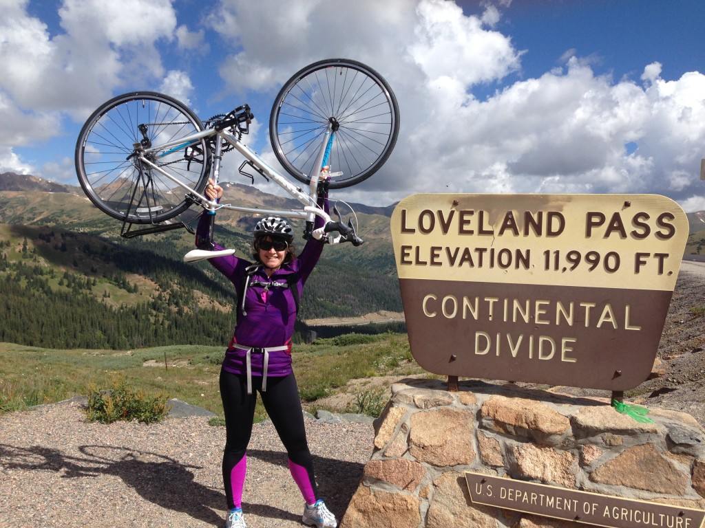 Marcy with her new bike after conquering Loveland Pass