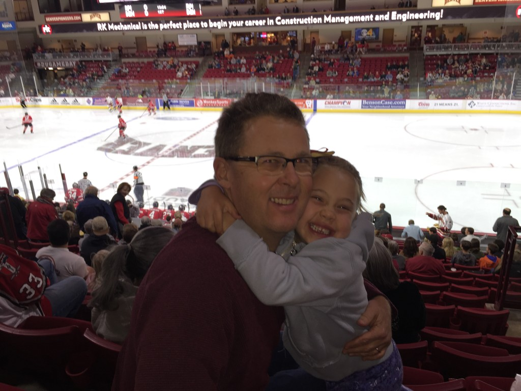 Anna at her first hockey game, the DU Pioneers