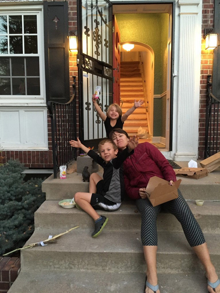 Celebrating our first meal back at our home with pizza on the front steps