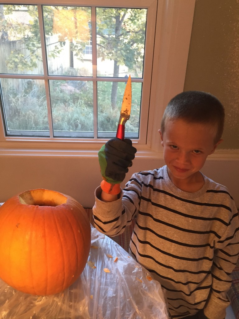 Jude doing some serious pumpkin carving