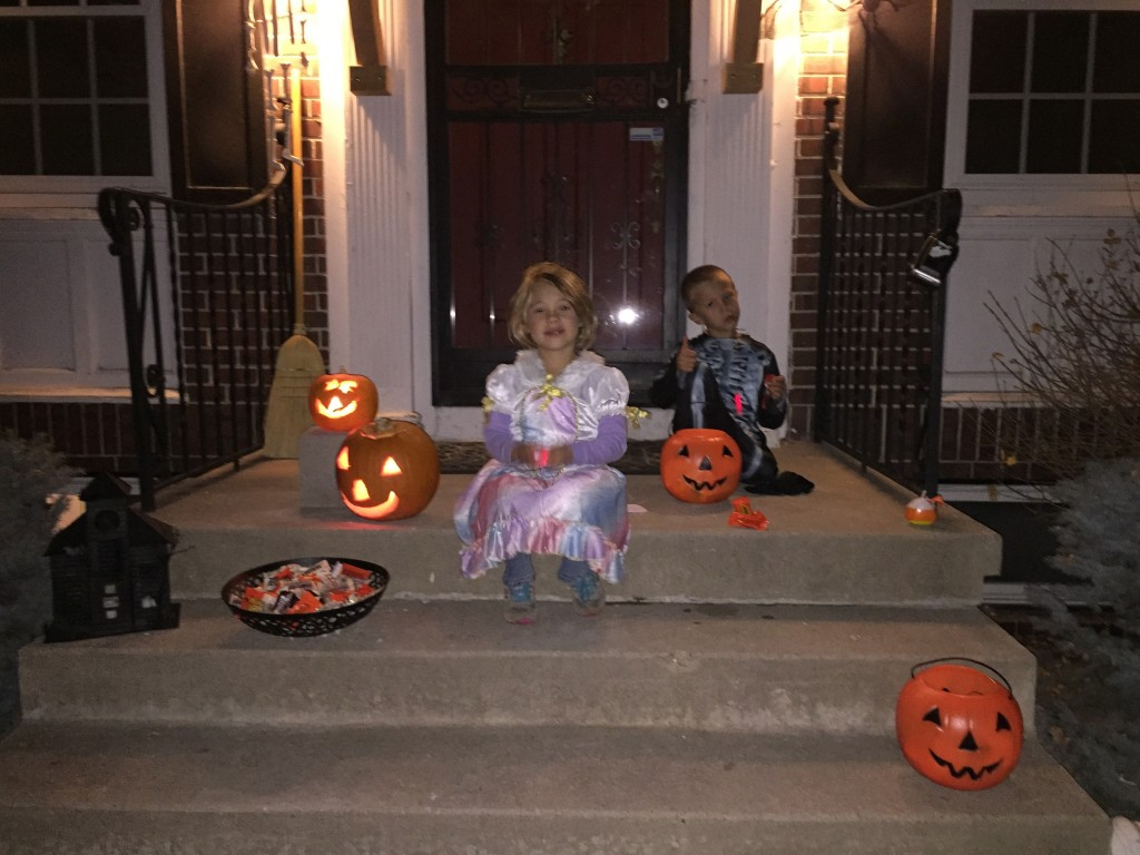Enjoying the candy haul on the front steps