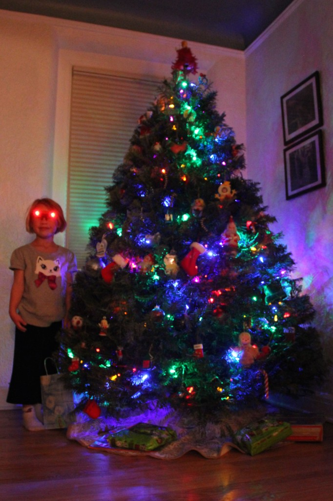 Anna shining bright by our Christmas tree