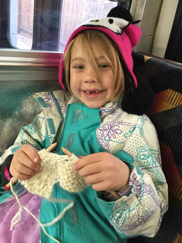 Anna doing her knitting on the bus downtown