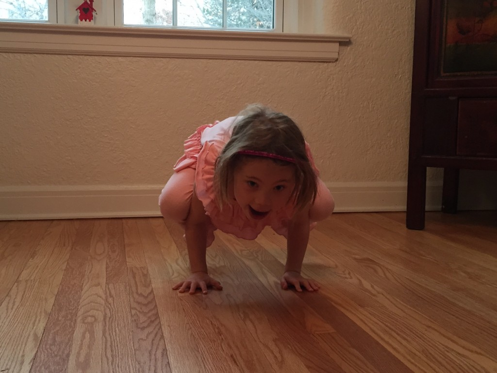 "Anna doing the ""crow"" yoga pose which takes tremendous upper body strength"