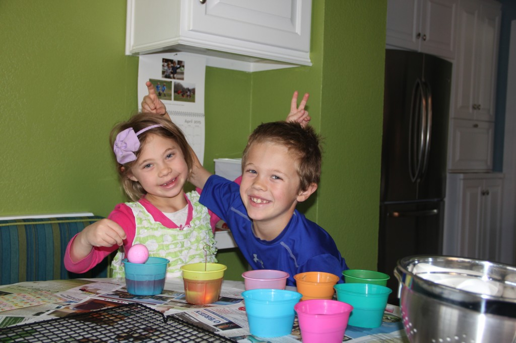 Anna and Jude goofing around as they dyed their Easter Eggs