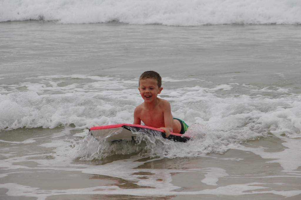Jude catching a wave on the boogie board