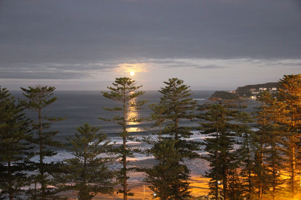 The view from our apartment of a spectacular moonrise over the ocean