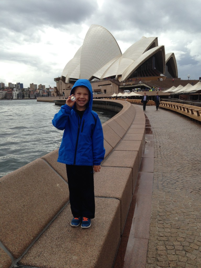 Jude showing off his commemorative coin in from of the Opera House
