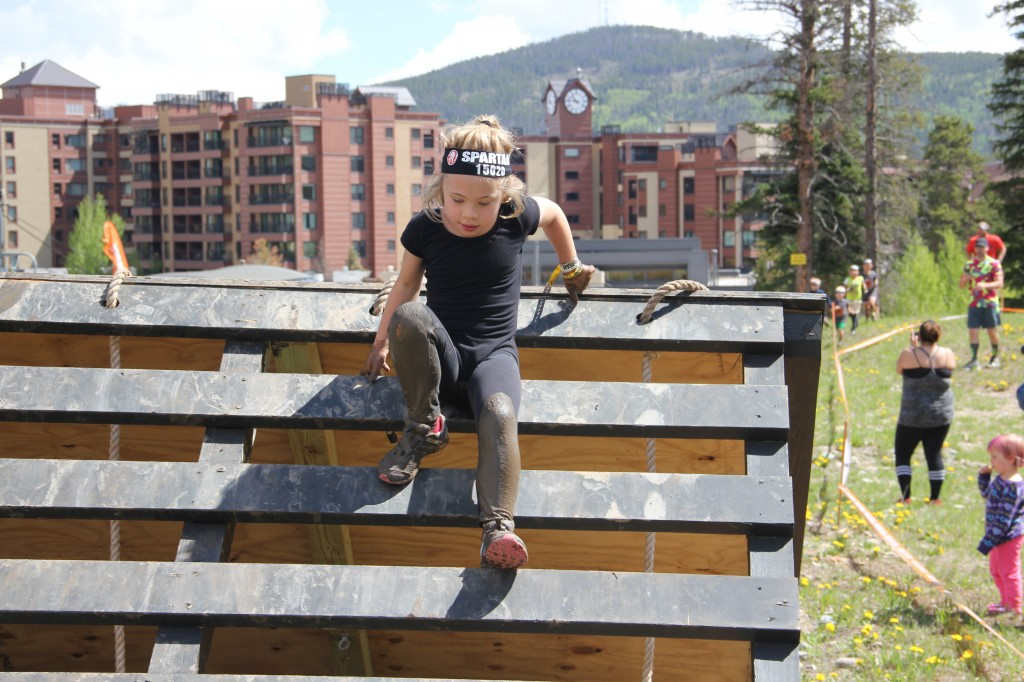 Anna going over an obstacle during the kids Spartan race