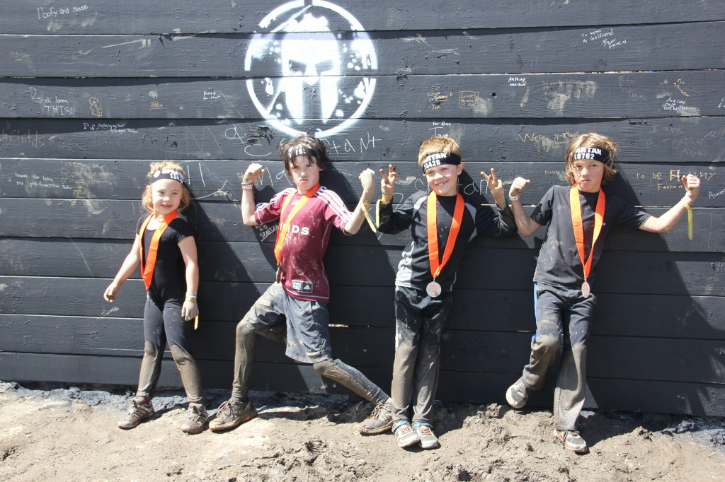 Anna, Griffin, Jude and Brody after the kids Spartan race