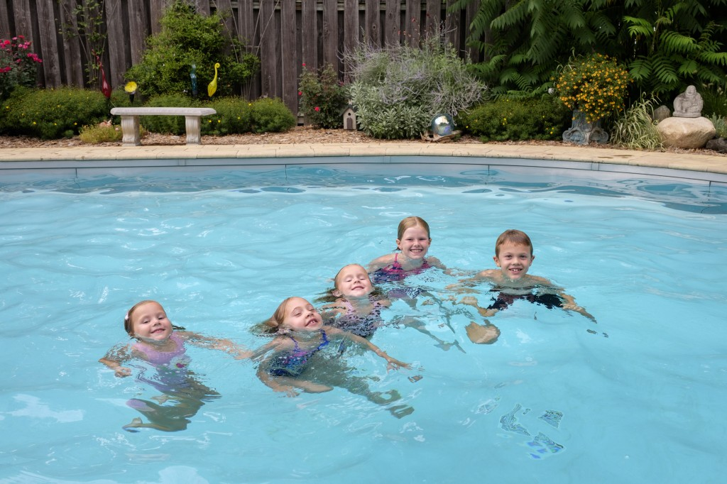 The five cousins playing in the pool