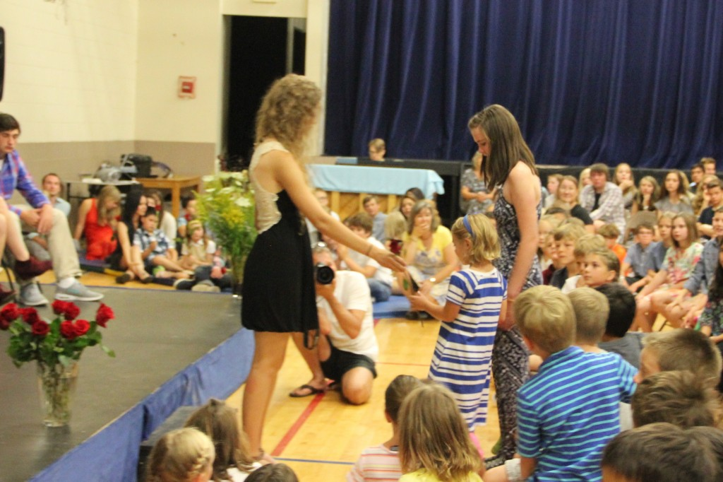 Anna receiving for rose at the special Rose Ceremony for first graders on the first day of school