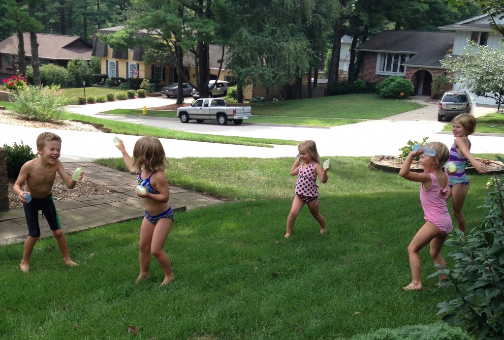 Water balloon fights in the front yard