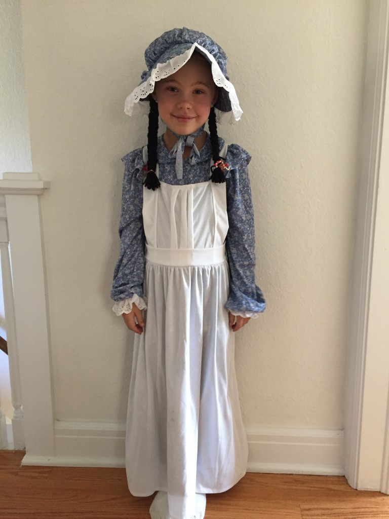 Anna in her Little House on the Prairie outfit