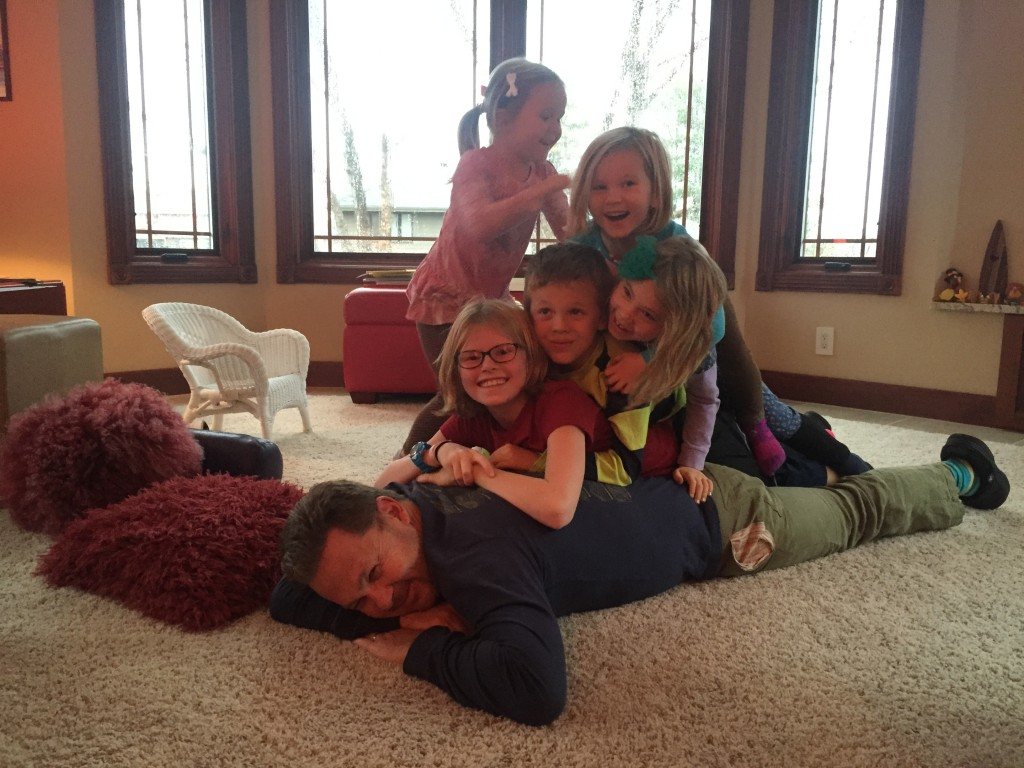 All the kids decide it was time to pile on Daddy/Uncle Peter
