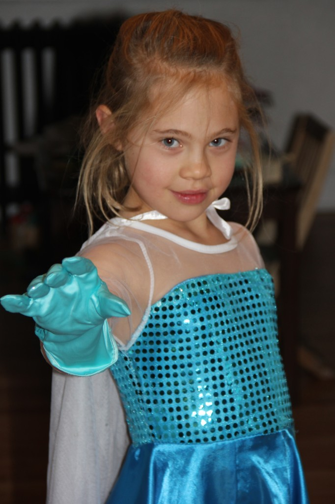 In her Frozen outfit with her new Elsa gloves