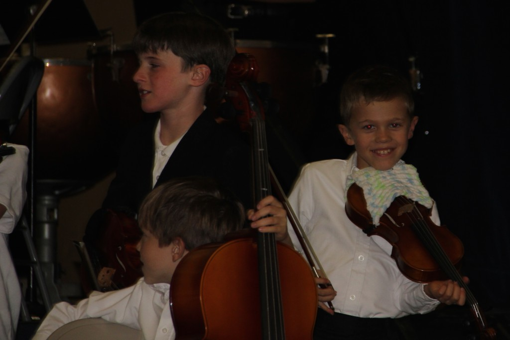 Jude playing the viola during their 3rd grade recital