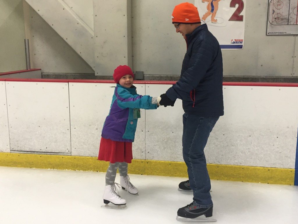 Anna helping me skate after her lesson
