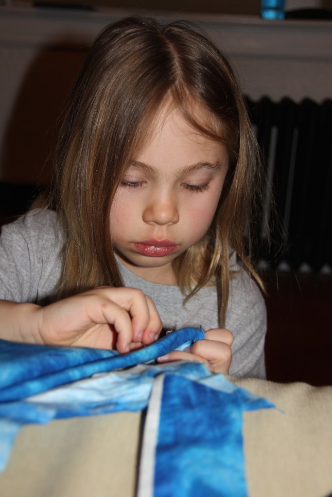 Anna sewing her new dress