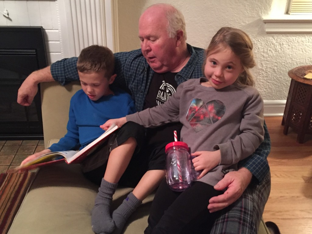 Grandpa reading stories to Jude and Anna