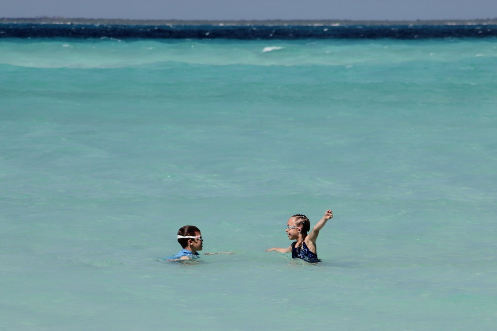 Jude and Anna in the pristine waters of Playa Norte on Isla Mujeres