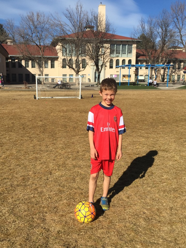 Playing soccer in his Arsenal gear