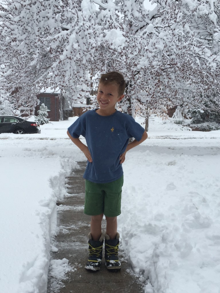 Jude checking out the snow in shorts, t-shirt and boots