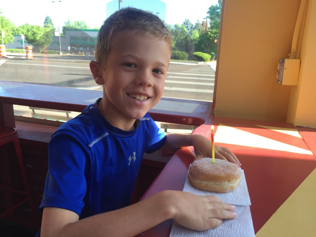 Jude celebrates his 9 1/2 birthday with a donut