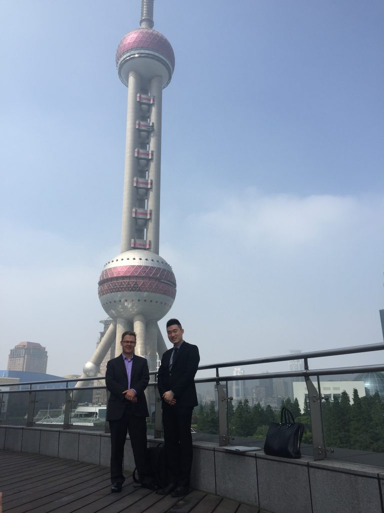 With our Chinese partner in Shanghai with the iconic TV Tower in the background