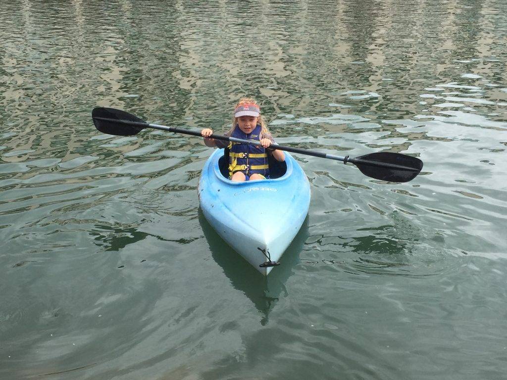 Anna going for her first solo kayak paddle on Keystone Lake