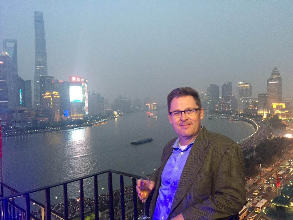 "At the Peace Hotel on the ""bund"" in Shanghai with the 2nd tallest building in the world in the background"