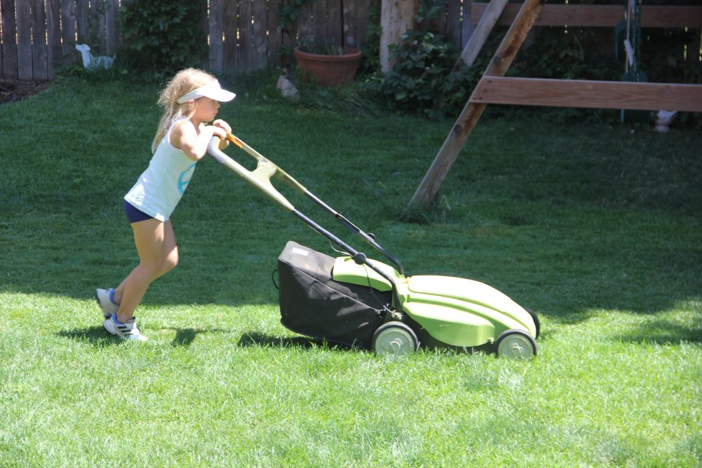 Anna mowing the lawn for the first time